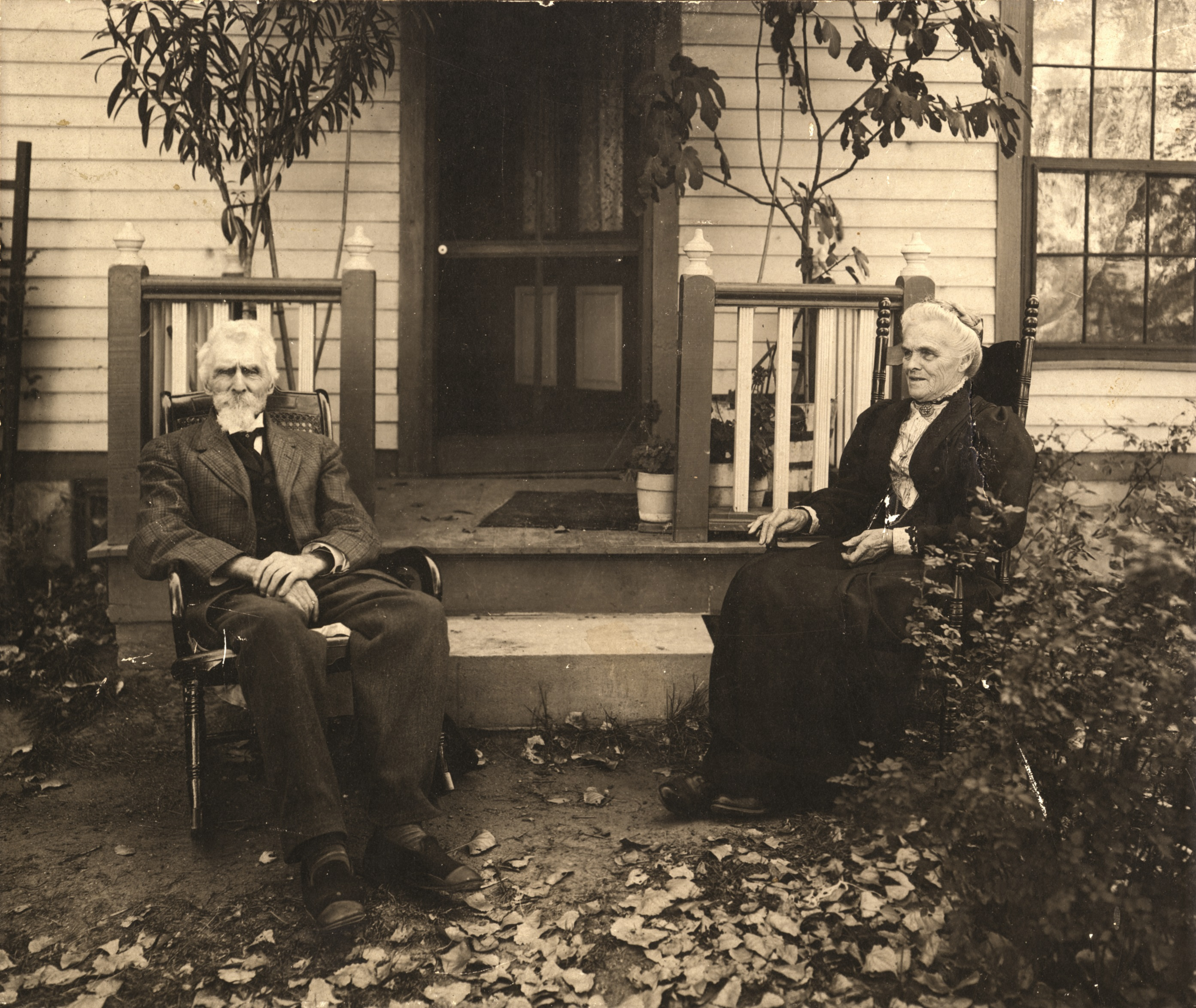 Levi and Millie Booth sitting outside of the house, ca. 1904.