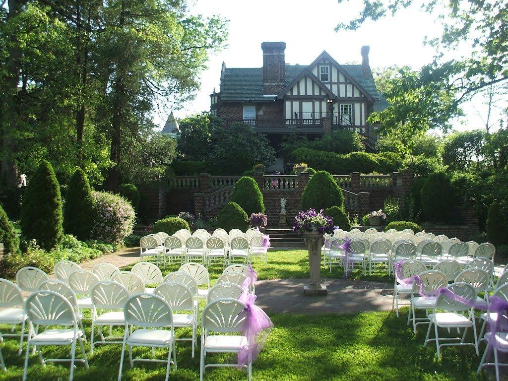 The mansion's sunken garden prepared for a wedding ceremony.