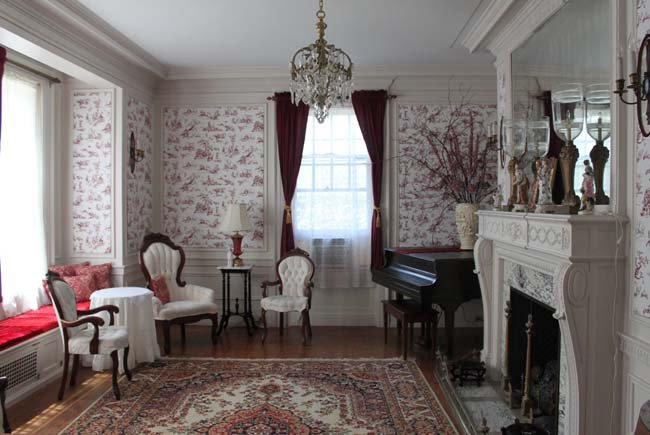 Another room within the mansion with period accents and furnishings.