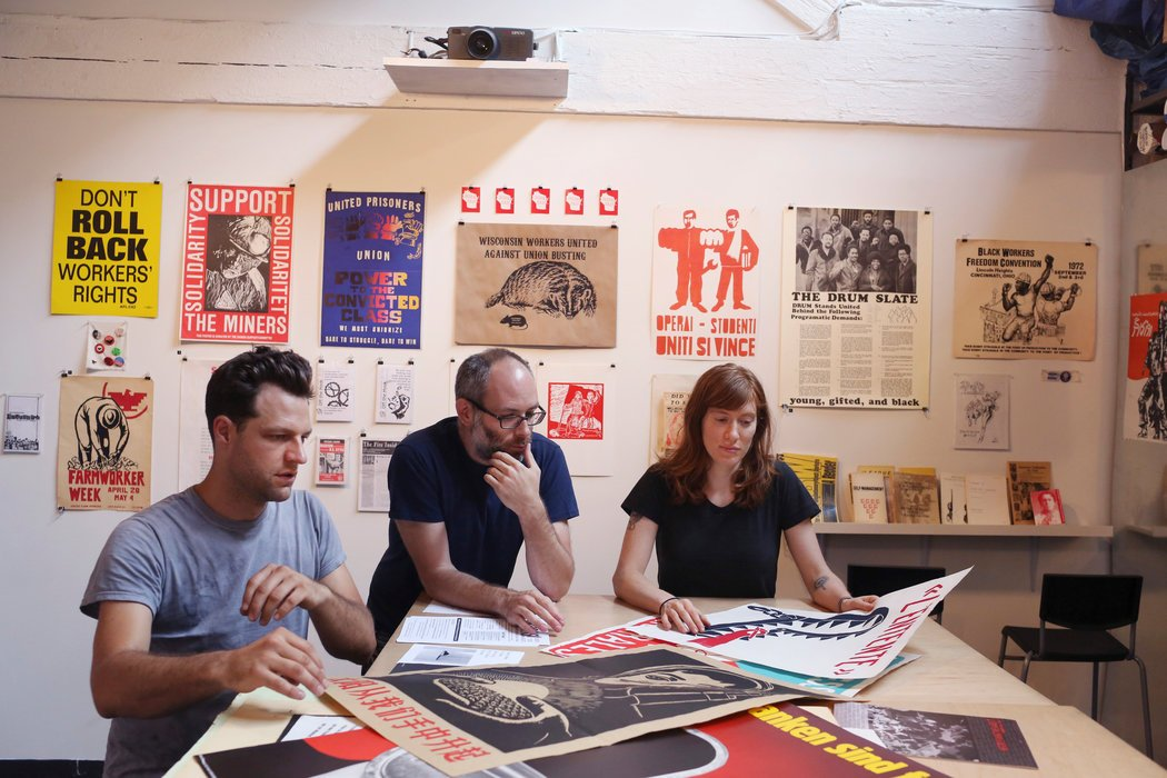 Kevin Caplicki, Josh MacPhee and Molly Fair at the Interference Archive. Credit: Michael Appleton for The New York Times