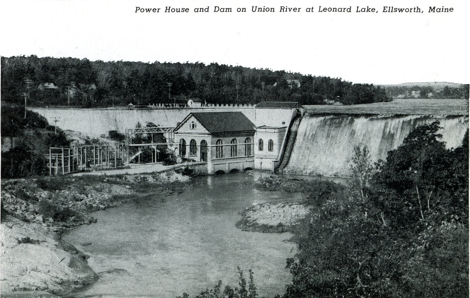 The Ellsworth Power House and Dam in 1920. Though the dam held as water spilled over and around it, the power house needed substantial repairs from the overflow and debris that crashed through the roof. (Ellsworth Public Library).