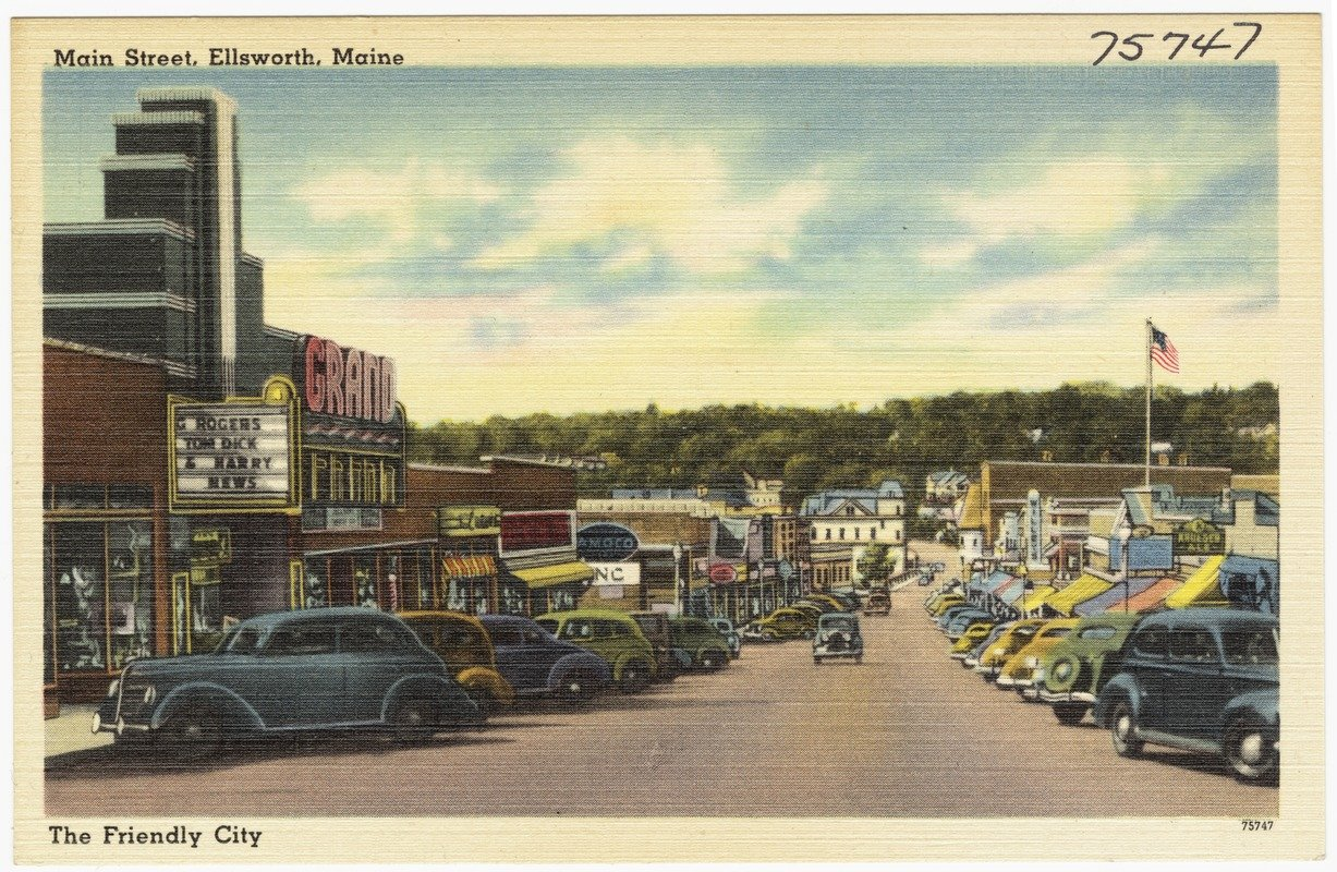 Main Street rebuilt only a few years later. The presence of the Grand Theater, at left, indicates this postcard's date of origin as after 1938, when the theater was completed.