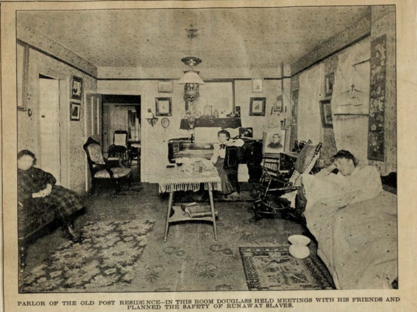 "This undated photograph is of the parlor in the old Post Residence. The figures are unidentified. The image of the parlor is captioned, ""In this room Douglass held meetings with his friends and planned the safety of runaway slaves."""