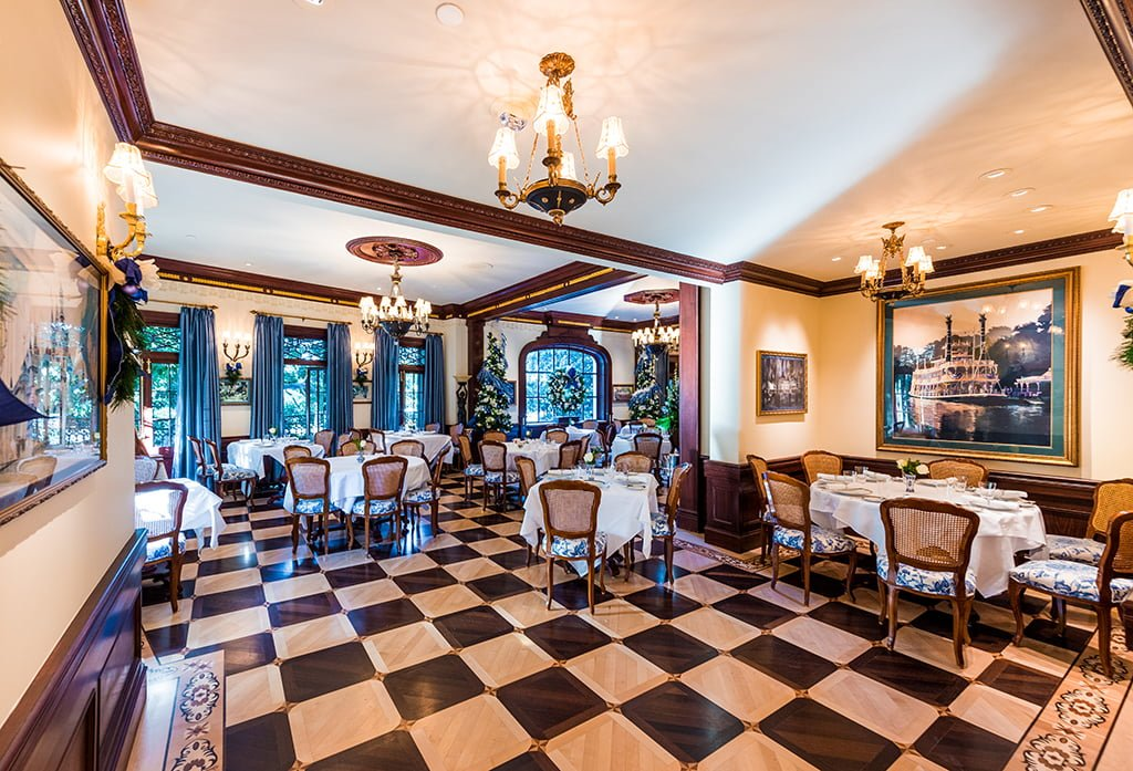 The dining room in Club 33 is decked out in a 19th-century New Orleans style