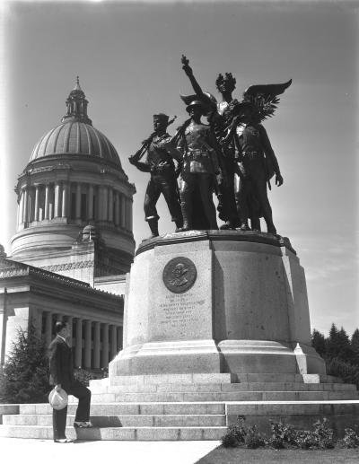 Shows Z.A. Vane standing in front of the Winged Victory memorial on Capitol Campus, June 20, 1938.