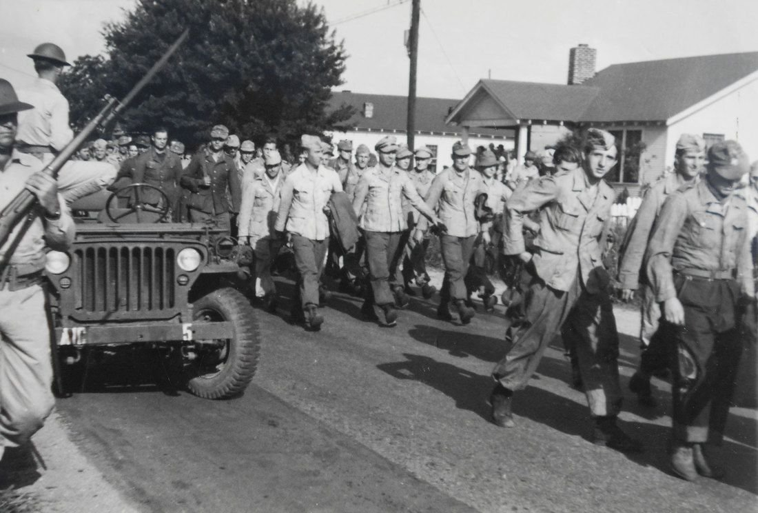 These German POW's are marching to Camp Aliceville on June 2, 1943.  They were the first ones from the train that was carrying POW's.