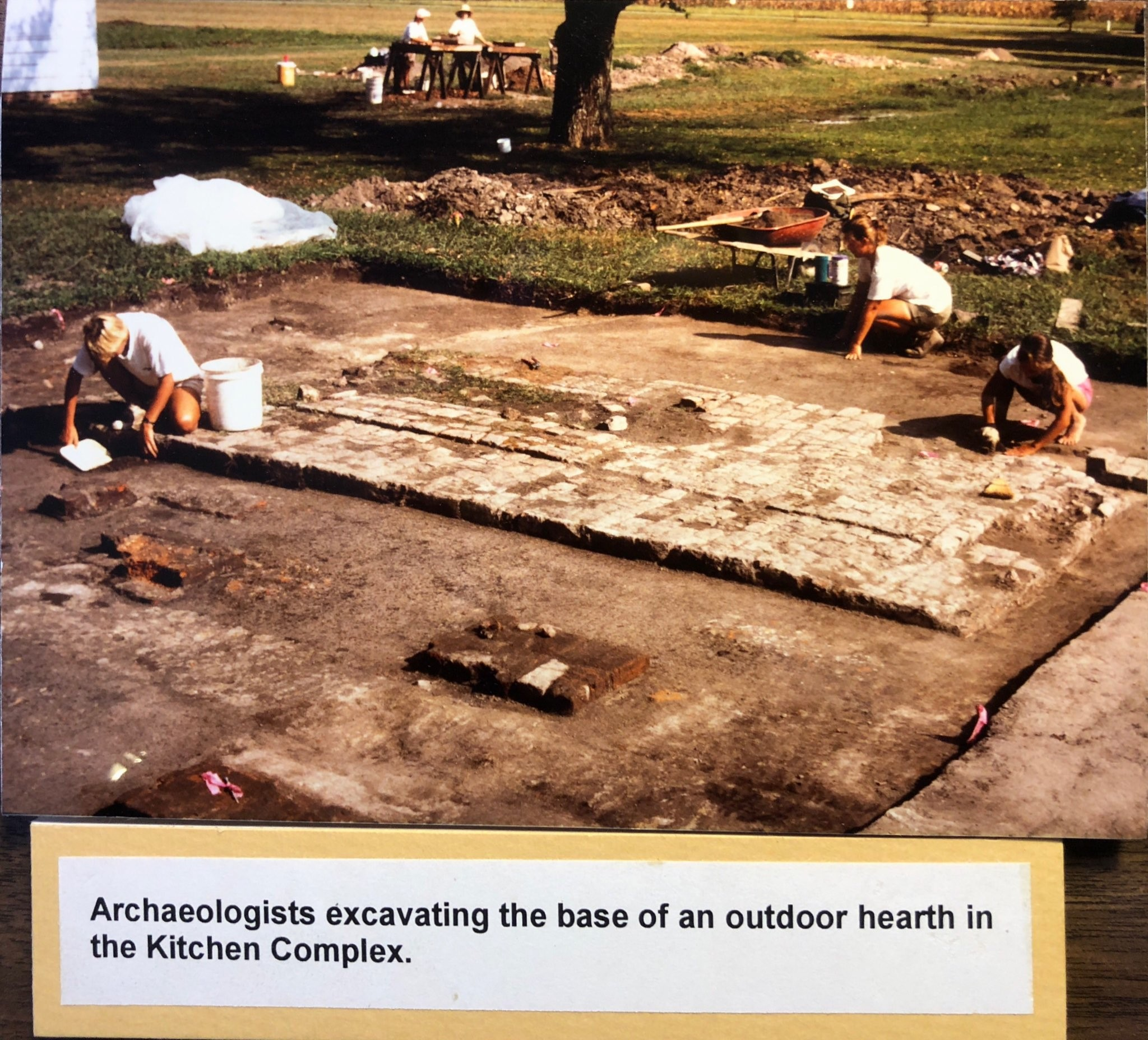 Archaeologists excavating the base of an outdoor hearth in the Enslaved Kitchen Complex in 1994.