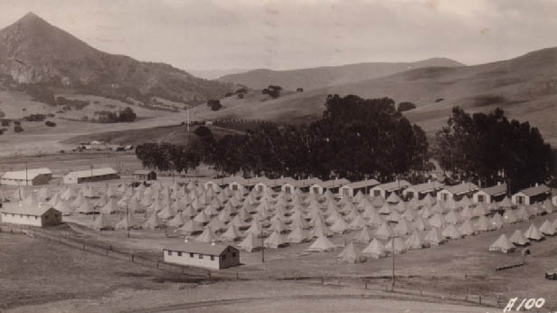 This shows troops that set up tents to camp out in while they are being trained at the camp.