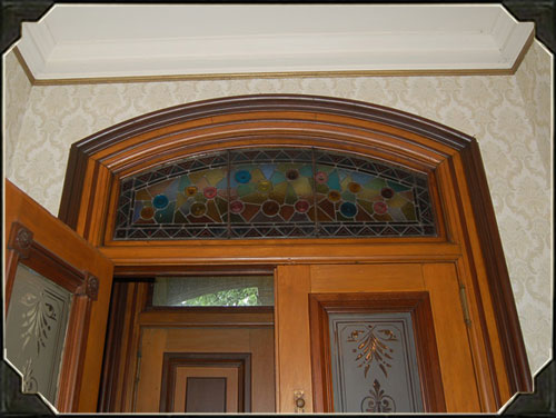 This Victorian style entryway boasts many different types of stained and etched glass.