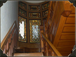 As you travel up the staircase that Ana Millikin had renovated, stop and look through the original stained glass windows.