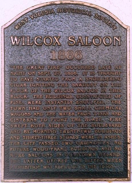 The plaque, located at 100 N Woodland Ave