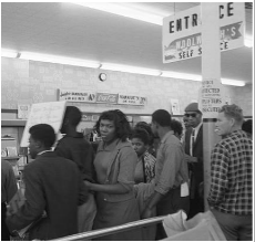 African American Students, accompanied by Joyce Cusack at the Woolworth's Sit In Protest, 1960 (Source: Getty Images)