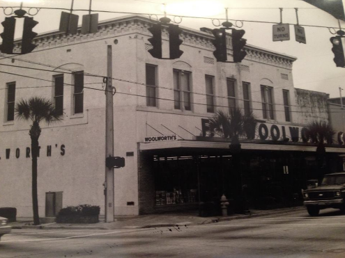 An outside view of the Woolworth's in downtown DeLand, on the corner of W. New York Ave. & N. Woodland Blvd, 1960