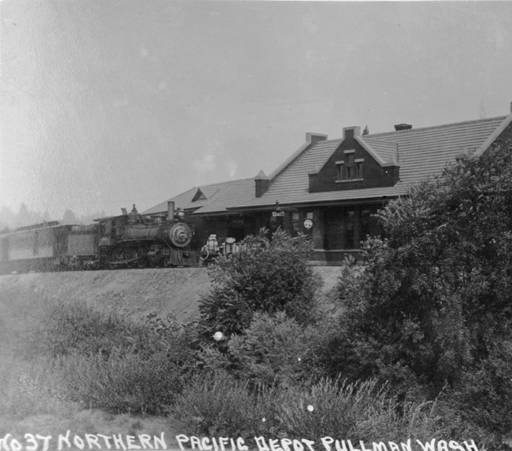 A train pulled to a stop in front of the depot, taken ca. 1920 by Artopho Studio. Courtesy WSU Special Collections. http://content.libraries.wsu.edu/cdm/compoundobject/collection/pullman/id/1131/show/23/rec/1