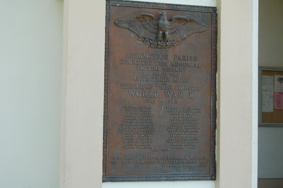 Dedicated to the fallen heroes of Assumption Parish, this plaque honors those who lost their lives in the Second World War.