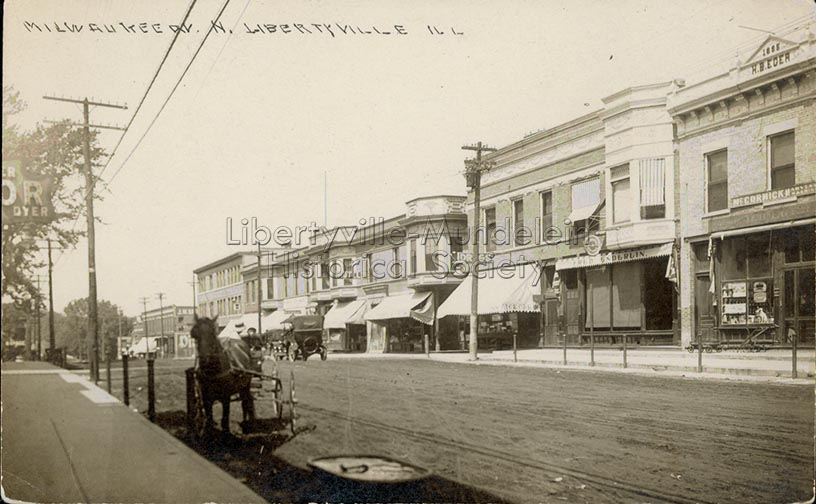 Looking north on Milwaukee Avenue,  Enderlin awning on right, circa 1913