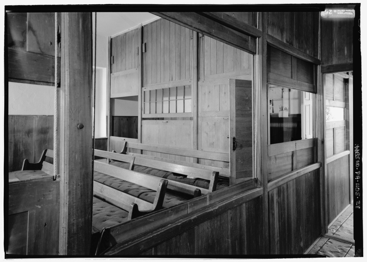 One of the portioned rooms within the meetinghouse.  Notice the ropes on the left which are used to move and slide the wooden panels that separate the rooms.