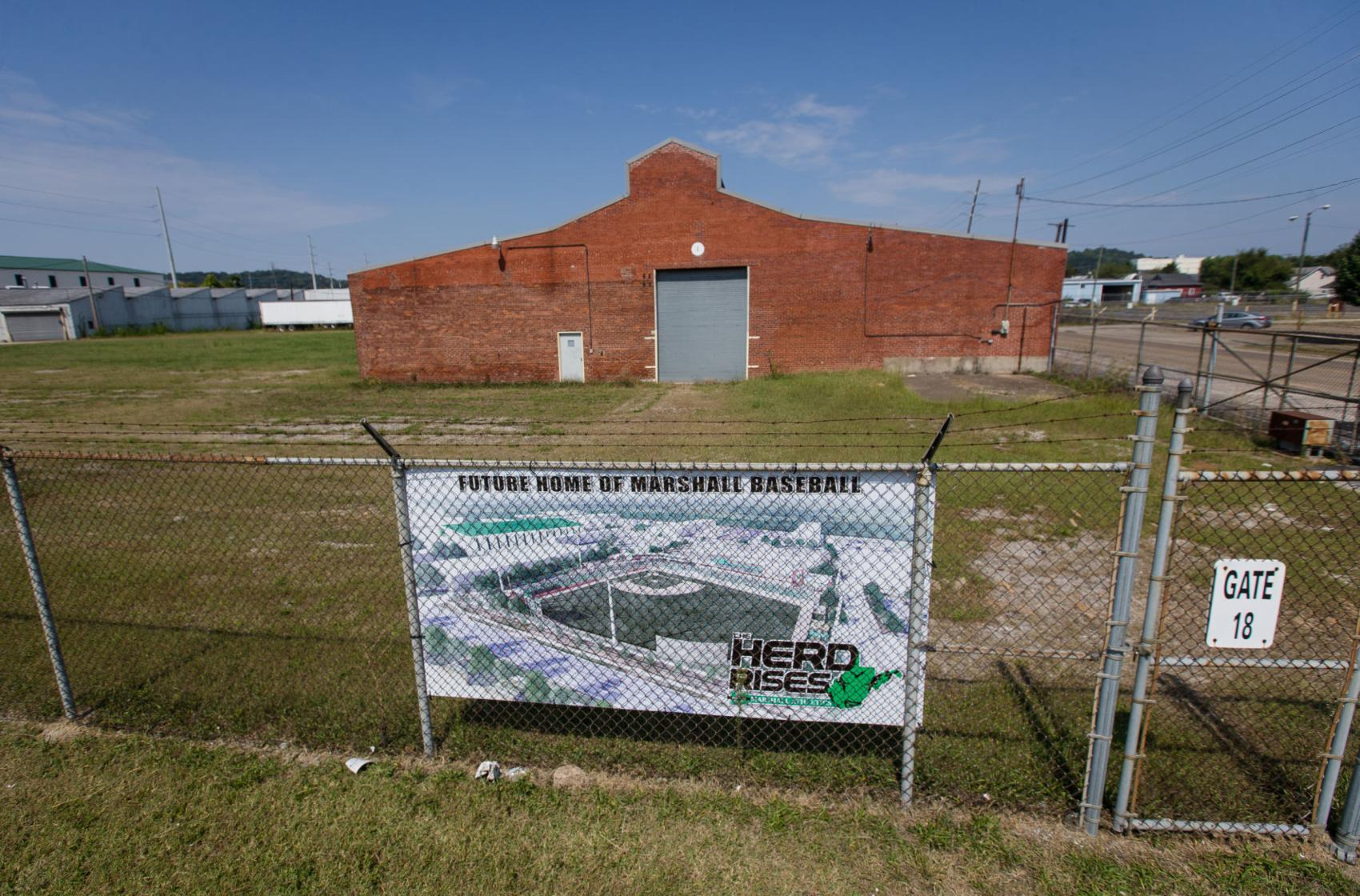 A sign at the former plant advertises the site of the future Marshall baseball stadium