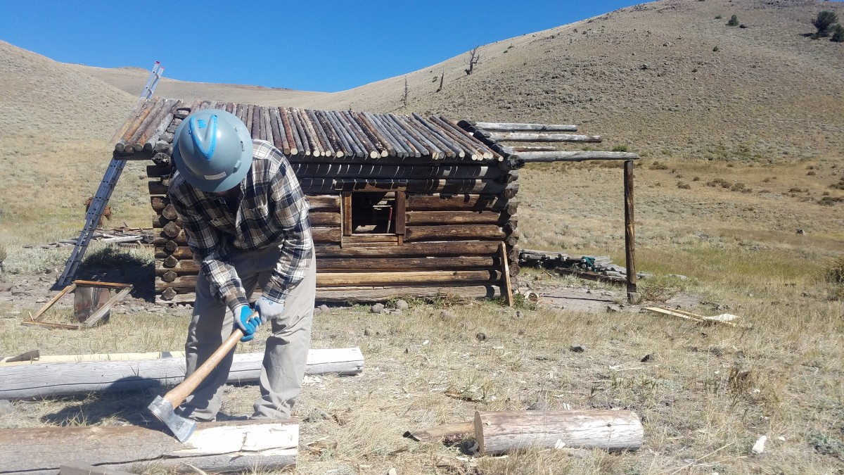 HistoriCorps volunteer working to preserve Anderson Lodge