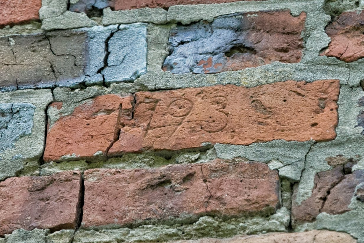 """Engraved in one of the bricks is """"1793""""."""