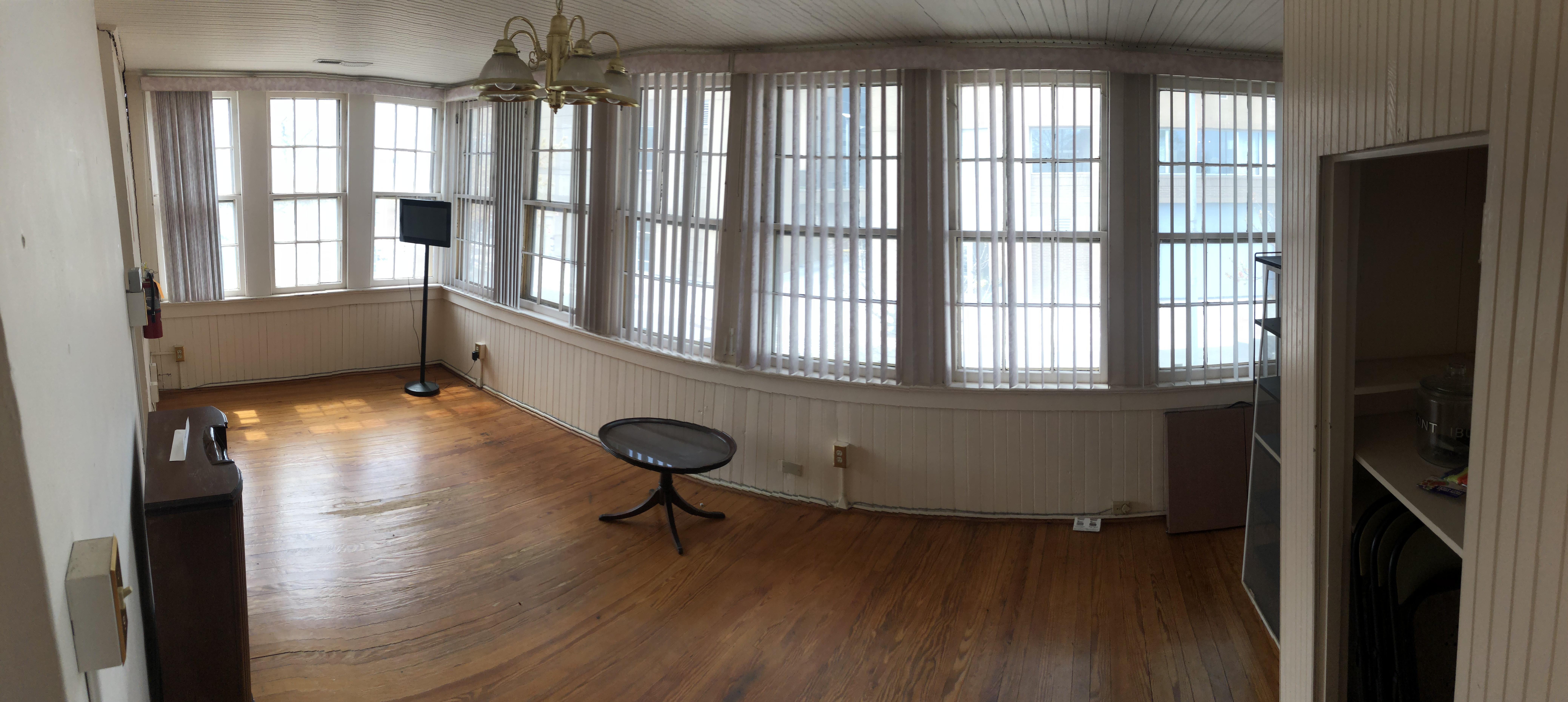"""As you can see the """"sun parlor"""" has many windows bringing in lots of sunlight. Family members would use this room to sunbathe, read, or study. Was also used as a maids quarters"""