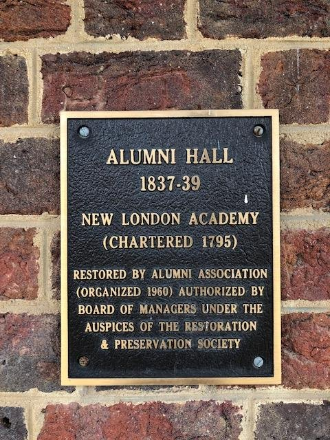 Presently the main historic structure has this Alumni Plaque. March 2019.