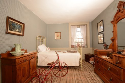 One of the upstairs bedrooms within the Parry Mansion.