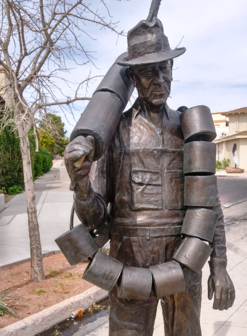 "Bronze sculpture near Frank Crowe Memorial Park, ""Alabam"", honoring workers who held ""mundane"" but important jobs during construction of Hoover Dam. Alabam helped keep the outhouses stocked with paper. (Source: M. Urashima, April 2018)"