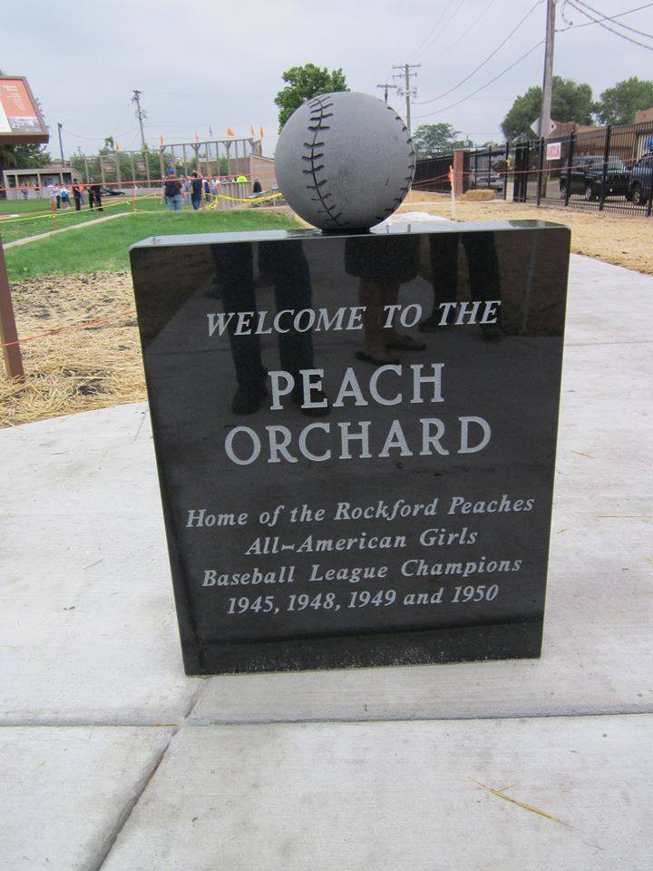 "The statue commemorating the ""Peach Orchard"" at the Beyer Stadium rededication"