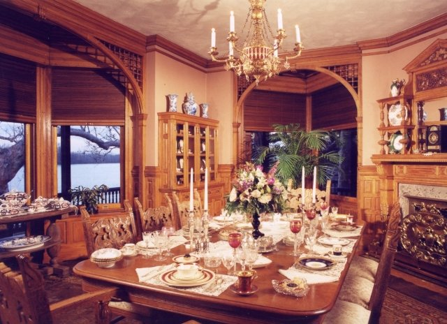 The Museum's dining room with ornately carved woodwork and original dinnerware.