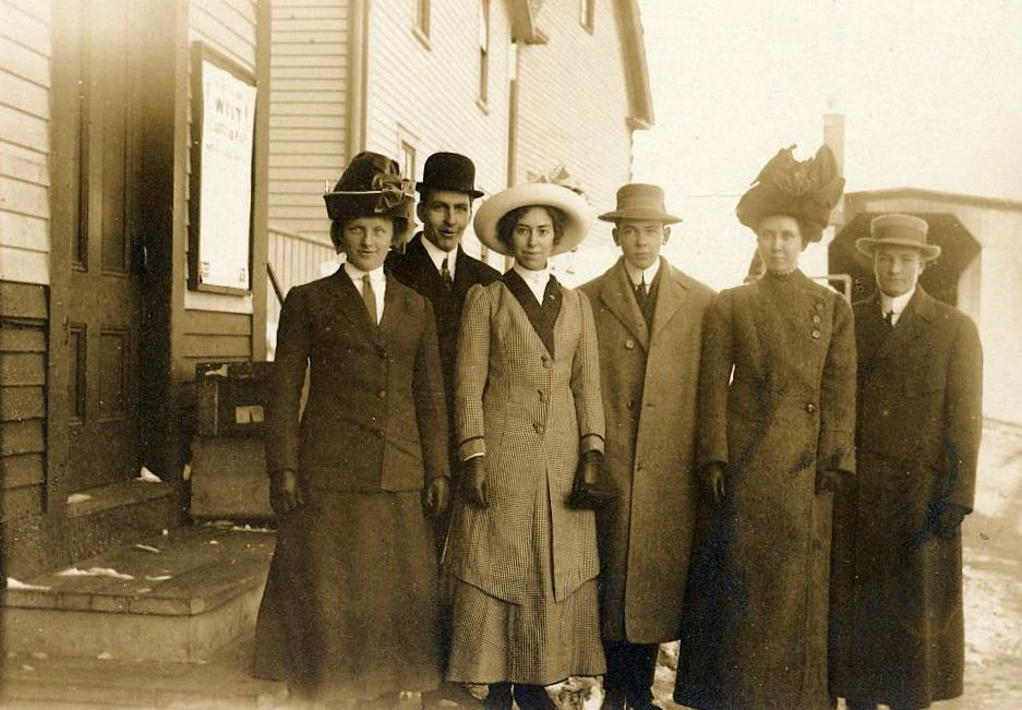 "Lovely image of six young people at the Contoocook Depot with the covered railroad bridge visible on the right.  Perhaps they were preparing to embark for a trip to the city?  Hand-written on the reverse ""Alice Fifield Richard Clough James Purrington Allice True (I think) Almond Corliss (I think)""  No indication is given as to the order of names or individuals.  However, Allice Fifield, Richard Clough, and James Purrington were all 1912 graduates of Hopkinton High School, and the males served in WWI.  Although the photo is not dated, it was likely taken sometime between graduation in 1912 and the U.S.'s entry into WWI in 1918."