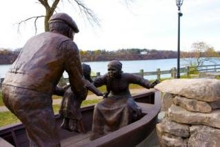 This monument depicts refugees leaving the United States at the Niagara River.