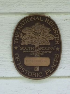 Marker on the building, located between the two front doors, for The National Register of Historic Places