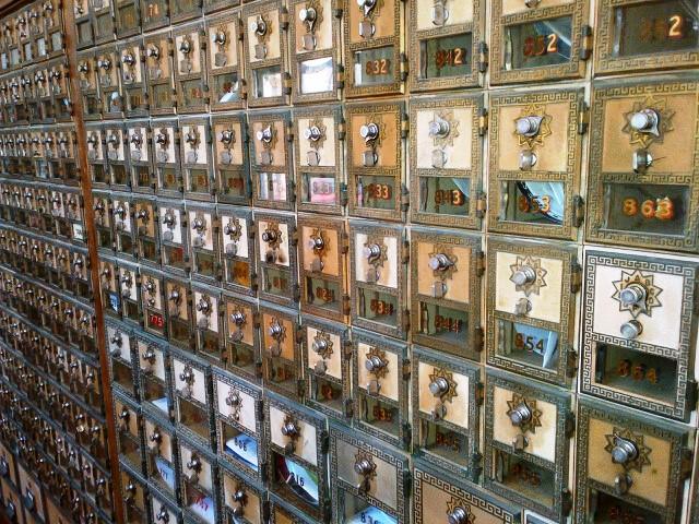 Brass postal boxes inside the Main Street Post Office, Huntington Beach, California. Source: M. Urashima, 2012.