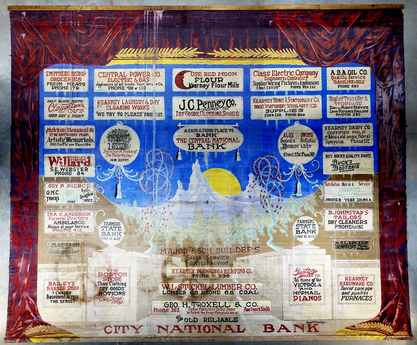 This advertising curtain is one of the few remaining artifacts related to the Kearney Opera House.