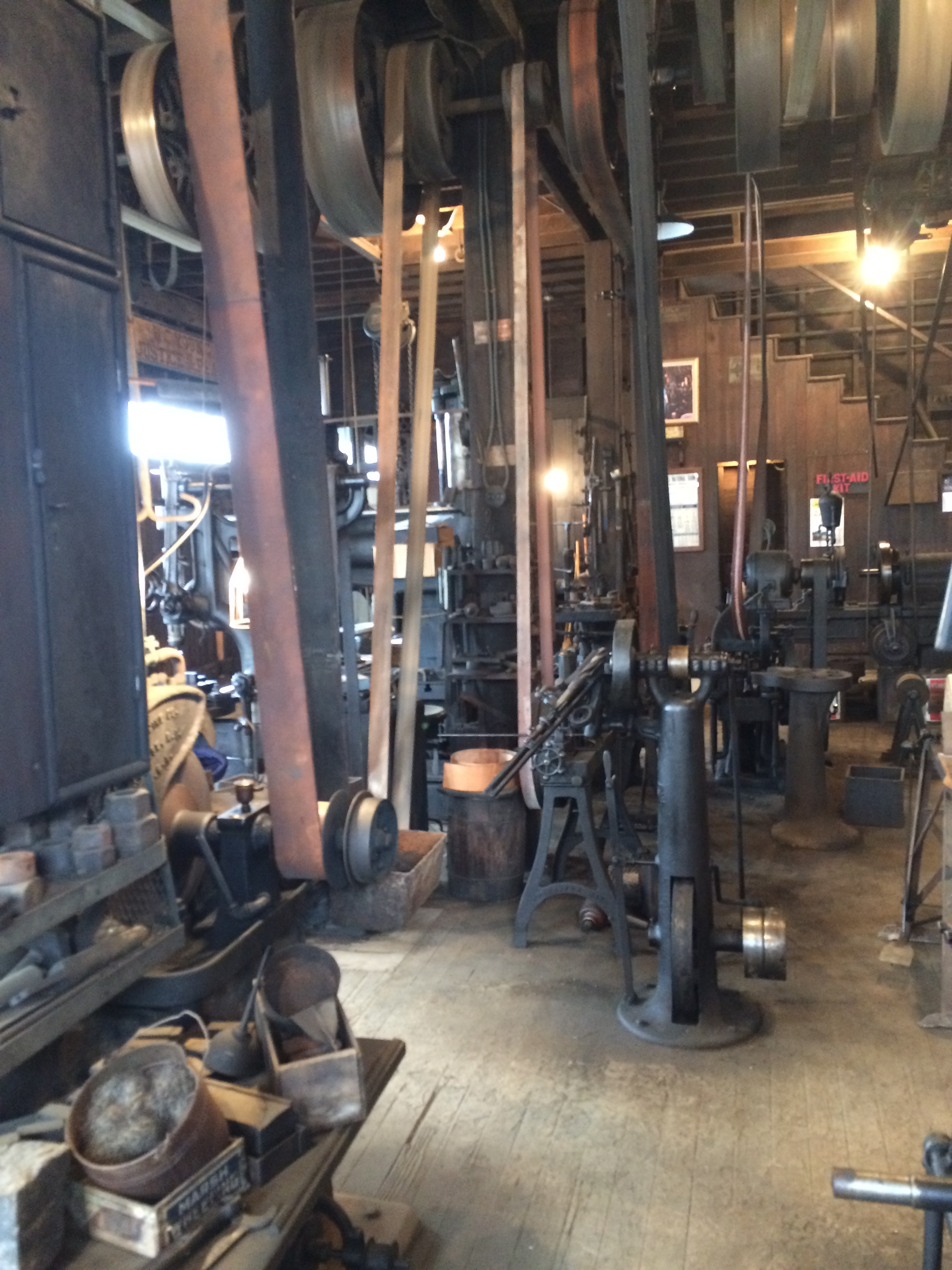 This photo shows the belt system used to run the various machines within the shop.
