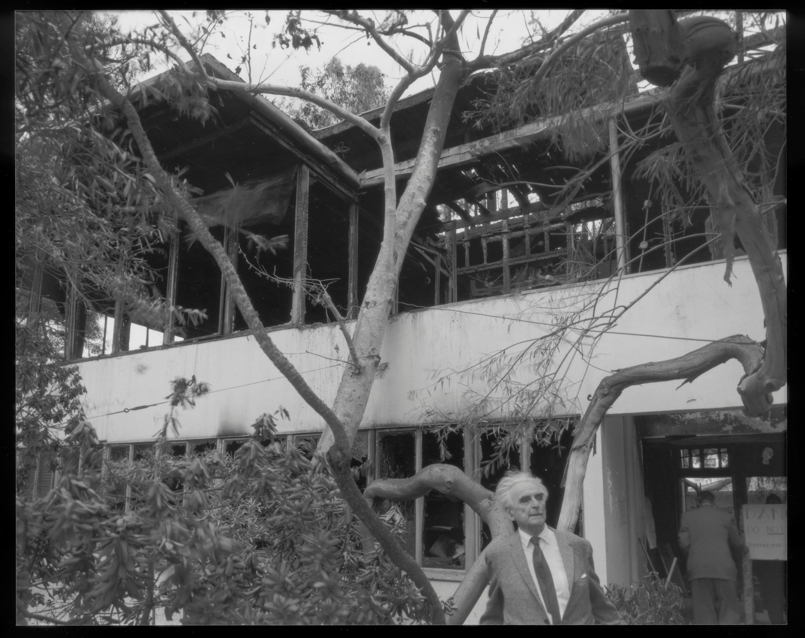 Richard Neutra standing outside his cherished home shortly after the 1963 fire.
