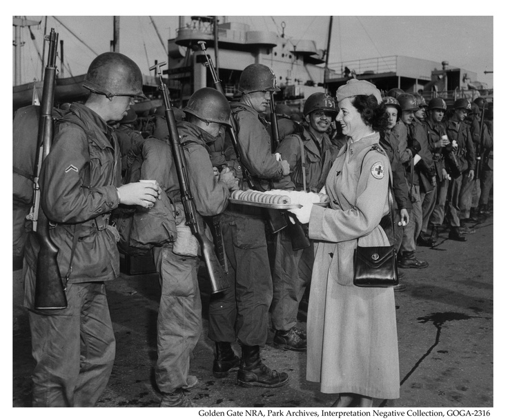 Soldiers being fed cookies and coffee by the American Red Cross