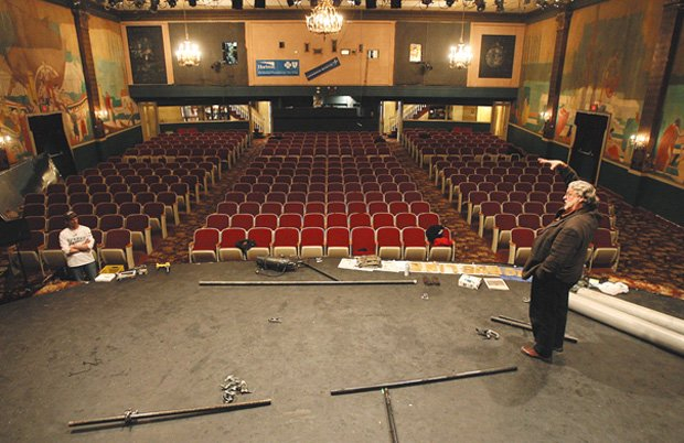 The savior of the Ritz, Bruce Curless, stands on the theatre's empty stage.