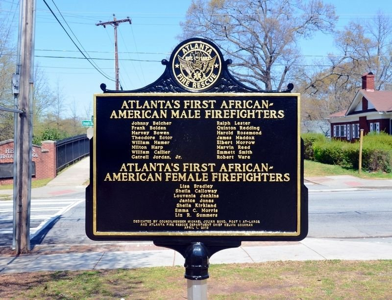 The second side of the marker. It lists the names of the first male and female firefighters that served Fire Station 16.There were 16 males were hired in 1962  and the 7 females were hired in 1977.