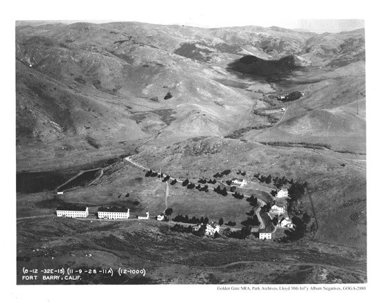 This photo shows Fort Barry nestled within the Marin Headlands. The army intentionally constructed the buildings around the main parade ground and planted trees around the post to provide necessary breaks from the wind. (photo circa 1928).