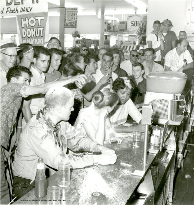 This iconic image of the Jackson Woolworth sit-in has come to symbolize the modern civil rights movement. At left sits John R. Salter, Jr. (a Native American who would change his name to Hunter Gray), Joan Trumpauer (later Joan Mulholland) one of two whit
