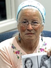 Joan Trumpauer Mulholland holds a photo of her mugshot prior to a commemoration of the sit-in in 2009