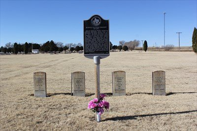 Photo taken from side of the highway. The marker is seen along with the headstones behind honoring each man who died on the expedition. Morton Memorial Cemetery can be seen in the background