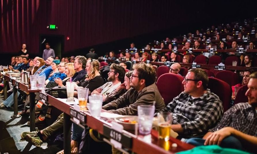 Audience combining dining and filmgoing at the Alamo Drafthouse Mainstreet theater