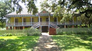"Here is a photo of the plantation's ""Big House.""  This photo also shows the Creole's building style, with tall ceilings. This house has a very rare construction style with only 14 other buildings like it in the state."