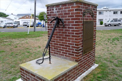 The monument for Leonard Lomell is replica of a grappling hook the men used to climb Pointe du Hoc on D-Day.