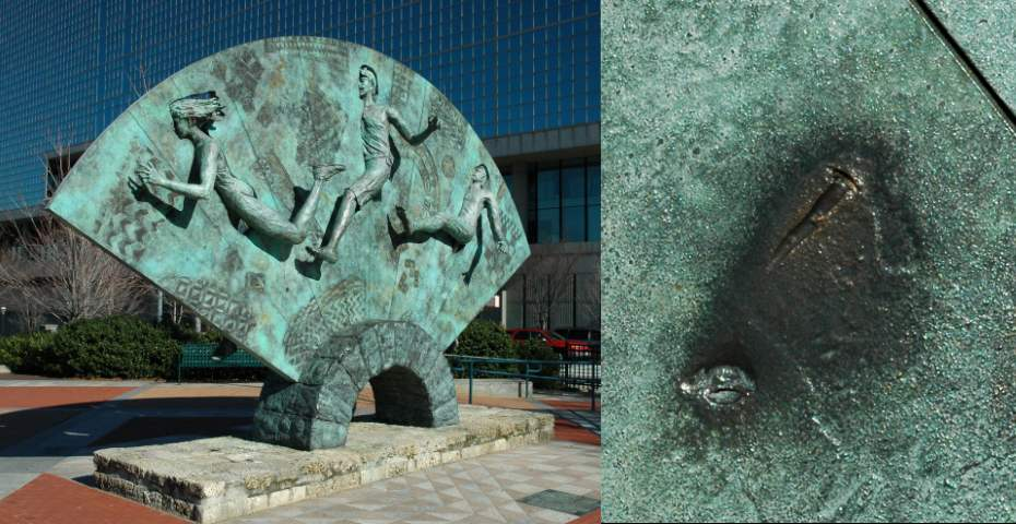 This is one of the many sculptures located in the park. It was located near the site of the bombing, as evidenced by the imprint of a screw in the closeup shot on the right side of the picture.