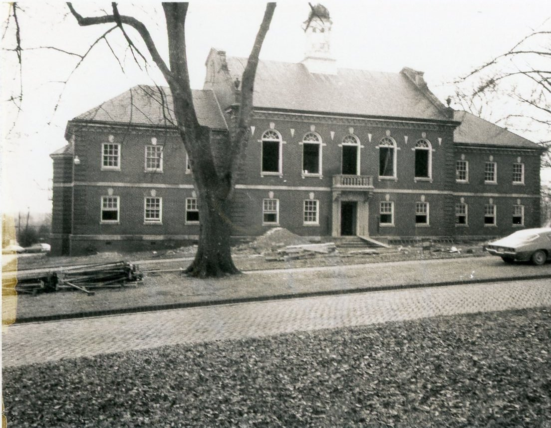 Black and White photo of the front of Calkins Hall during a renovation.