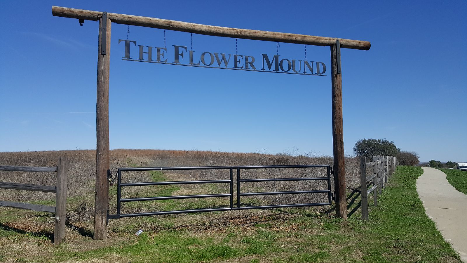 The entrance to The Flower Mound with the recently updated farm fencing.  Photo taken in March 2018.